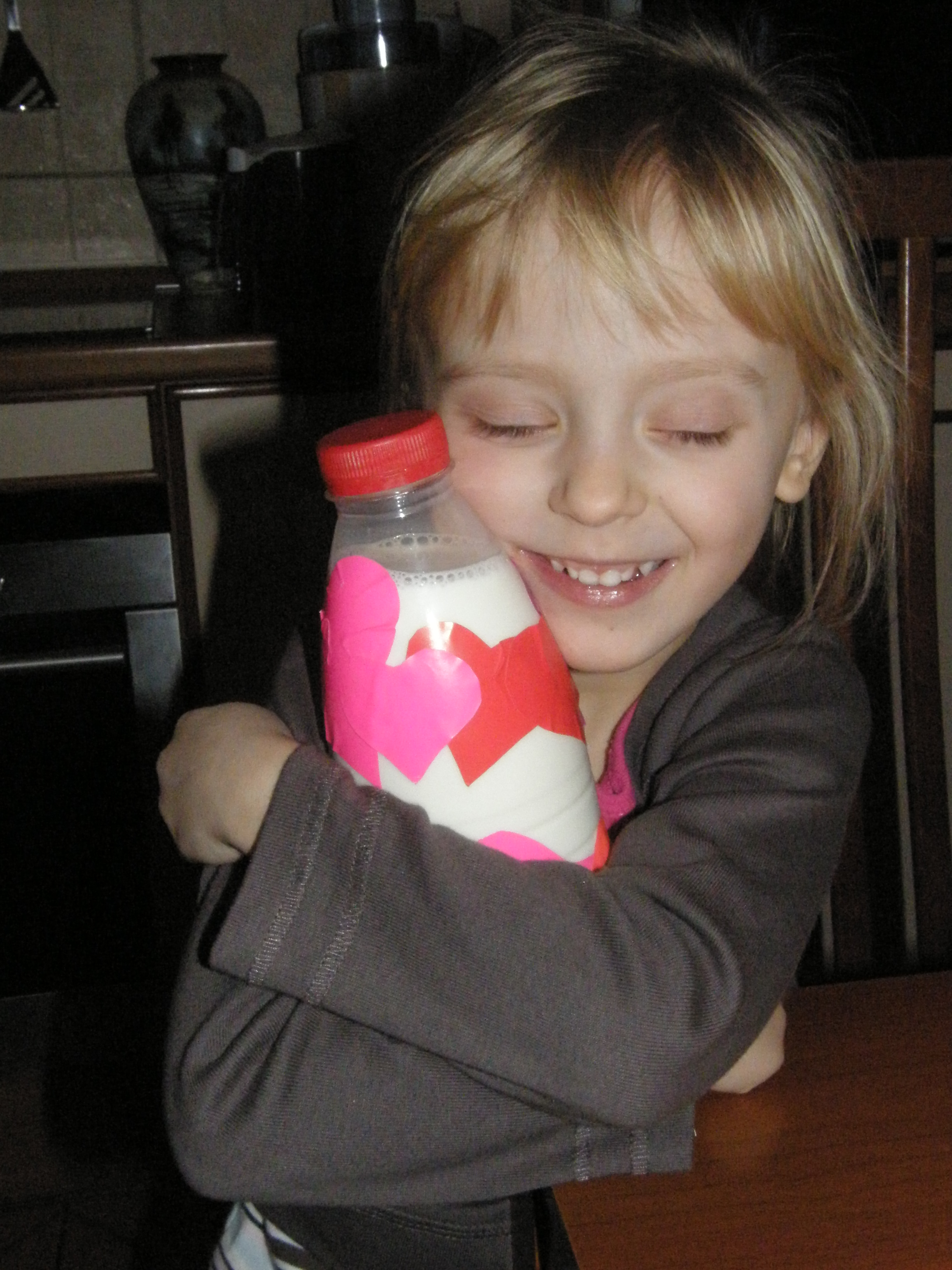 Laughing Poli with heart bottle.JPG